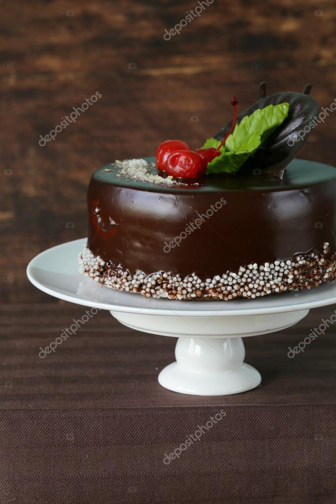 Festive Beautiful Chocolate Cake With Icing And Cherry Stock Photo