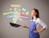 Fényképek Fiatal nő főzés vitaminok és ásványi anyagok