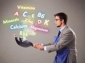 Fényképek Ember főzés vitaminok és ásványi anyagok