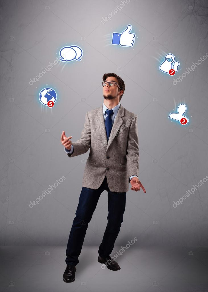 Handsome young boy juggling with social media icons