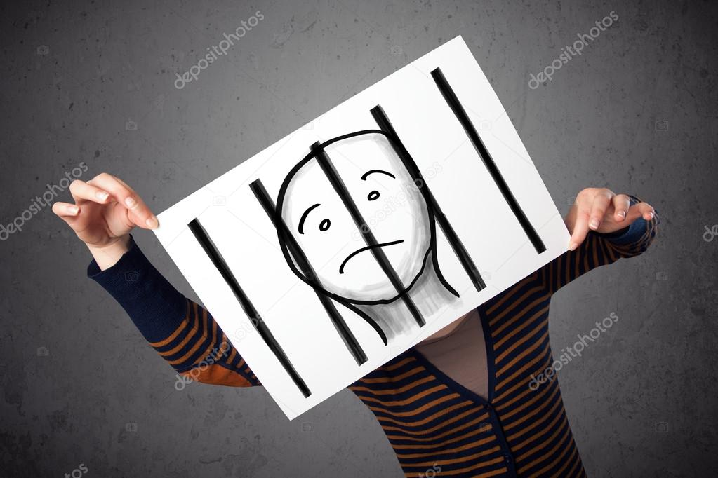 Woman holding a paper with a prisoner behind the bars on it in f