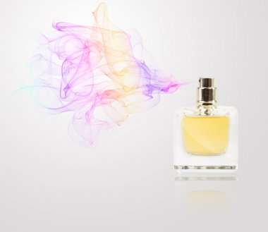 Perfume bottle spraying colored scent
