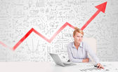 Fotografie Business woman sitting at table with market diagrams