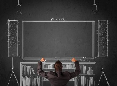 Businessman in front of a home cinema system
