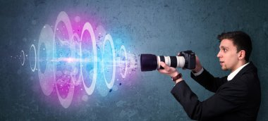 Young photographer making photos with powerful light beam stock vector
