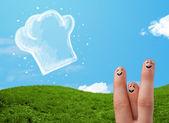 šťastný Veselý obličej prsty při pohledu na obrázek vařit klobouk