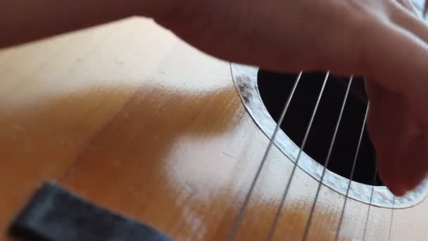 The musician playing on classical Spanish guitar