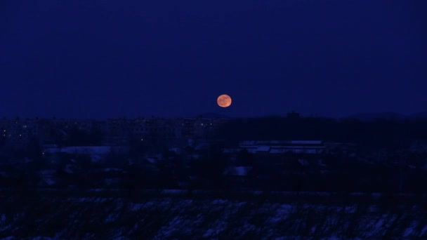 Time Lapse of Moon Rising over city.