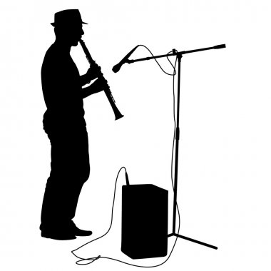 Silhouette musician plays the clarinet.
