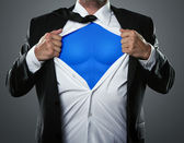 Fotografie Businessman acting like a super hero
