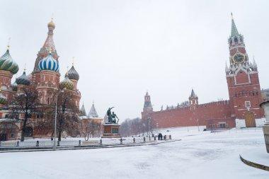 St Basil Temple and Spasskaya Tower of Kremlin during snowstorm