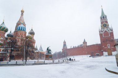 St Basil Temple and Spasskaya Tower of Kremlin during snowstorm