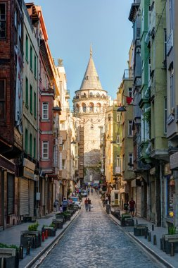 View of old narrow street with the Galata Tower in Istanbul, Turkey