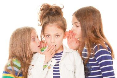 kids whispering bad news