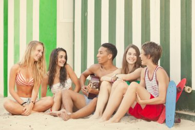 beach party with teens and guitar