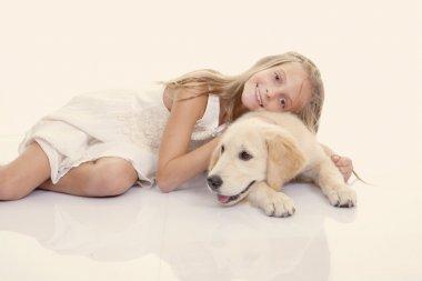 Family pet girl hugging dog