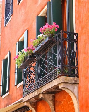 Picturesque balcony with flowers in an old Italian house