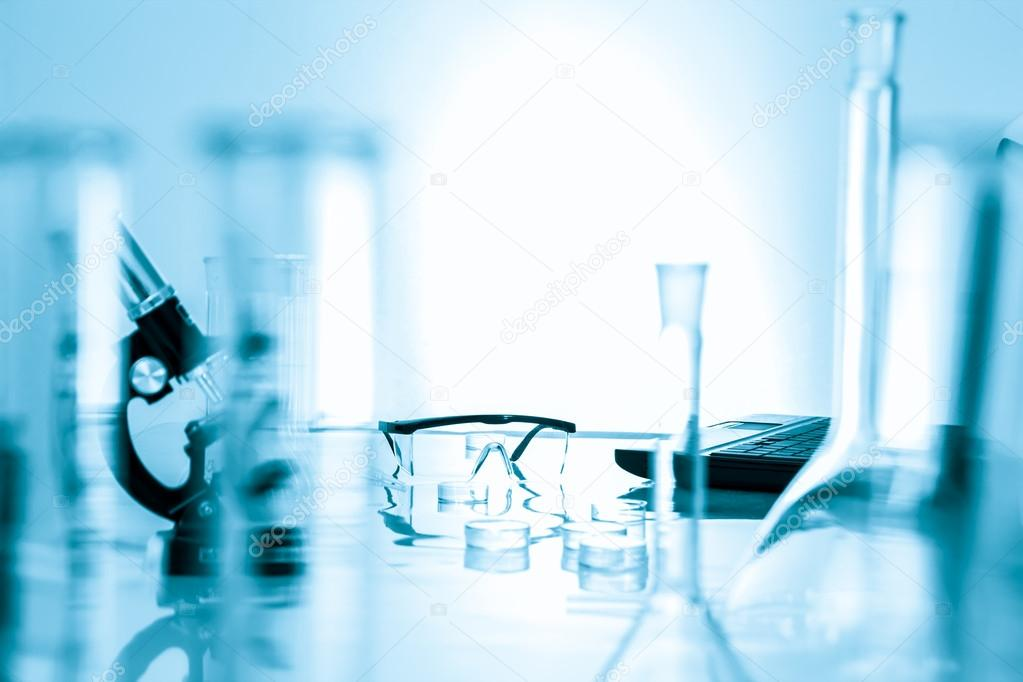 Microscope and test tubes used in laboratory .medical glassware