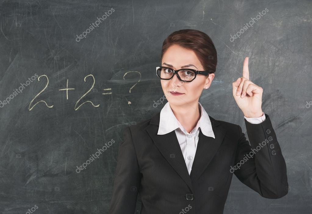 Woman teacher teaching maths — Stock Photo © DarkBird #28640409