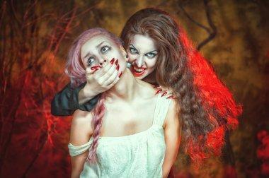 Halloween vampire and her victim