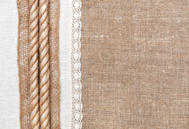 Burlap background with linen cloth and rope