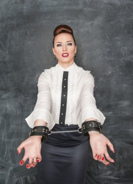 Business woman with handcuffs on her hands