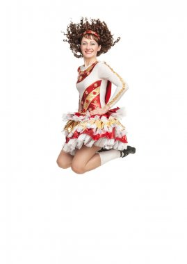 Young woman in irish dance dress jumping
