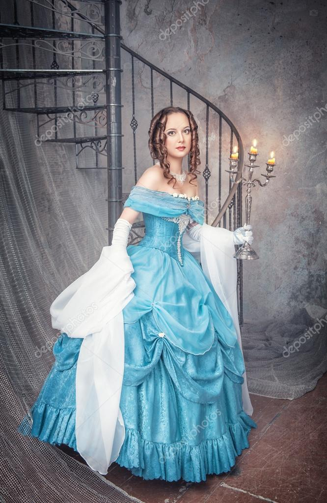 Beautiful woman in blue medieval dress with candelabrum — Stock ...