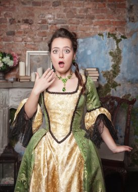 Surprised beautiful woman in medieval dress
