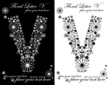 Two black and white letters of vintage floral alphabet, V