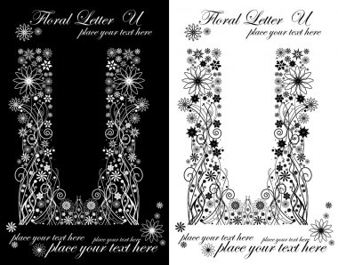 two black and white letters of vintage floral alphabet, U