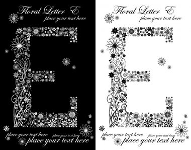 two black and white letters of vintage floral alphabet, E