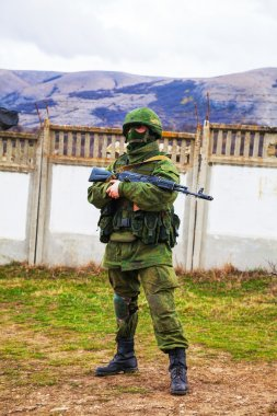 Russian soldier guarding an Ukrainian naval base in Perevalne, C