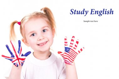 American and English flags on child s hands Learning English language concept