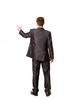 Happy young businessman's back pointing finger