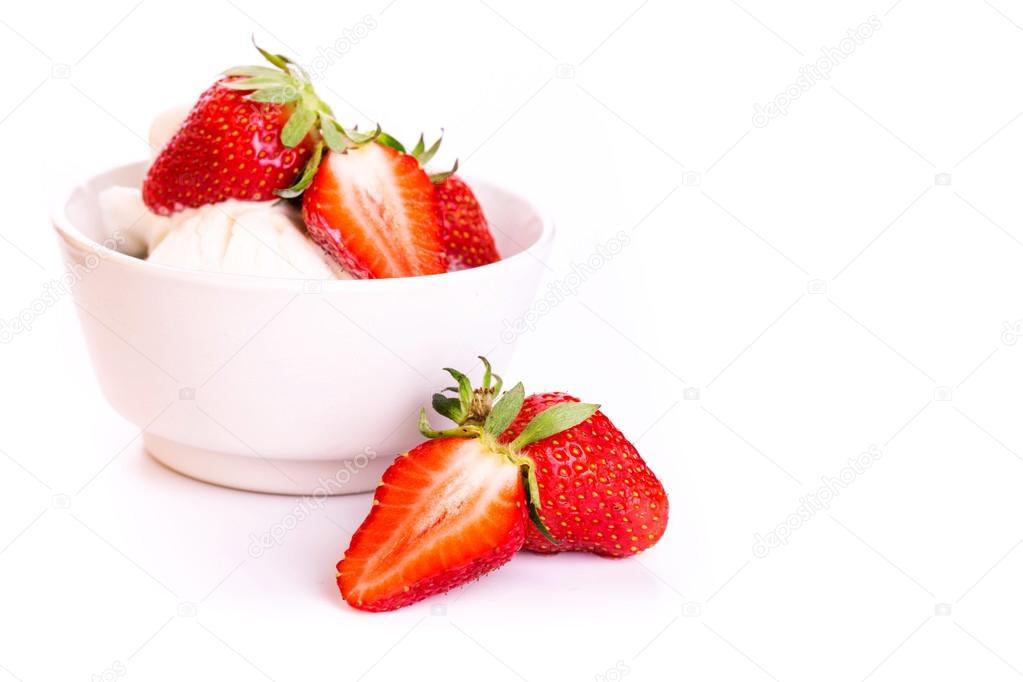 Fresh ice cream in a plate with strawberry