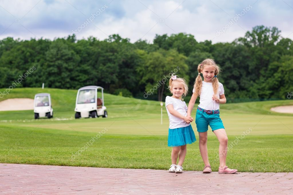 Cute little gilrs on the golf course