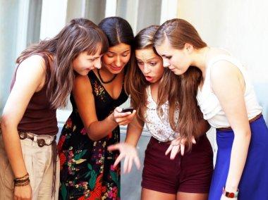 Beautiful student girls during phone call