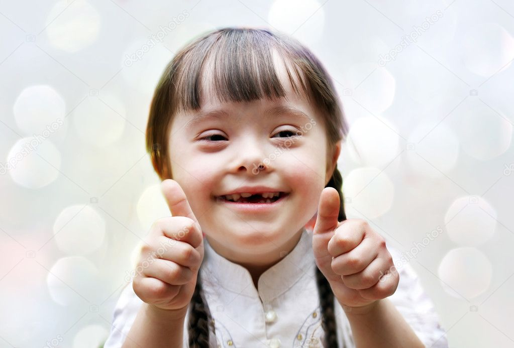 Portrait of beautiful happy girl giving thumbs up.