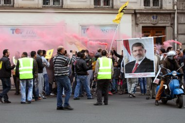 Egyptian Pro-Morsi protesters take part in a demonstration on Apr.25, 2014 in Paris, France. Mohamed Morsi served as the fifth president of Egypt, from June 2012 to July 2013