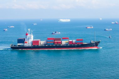 cargo ship with containers sailing on the sea