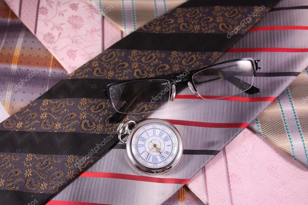 Multicolored ties, vintage watches and glasses
