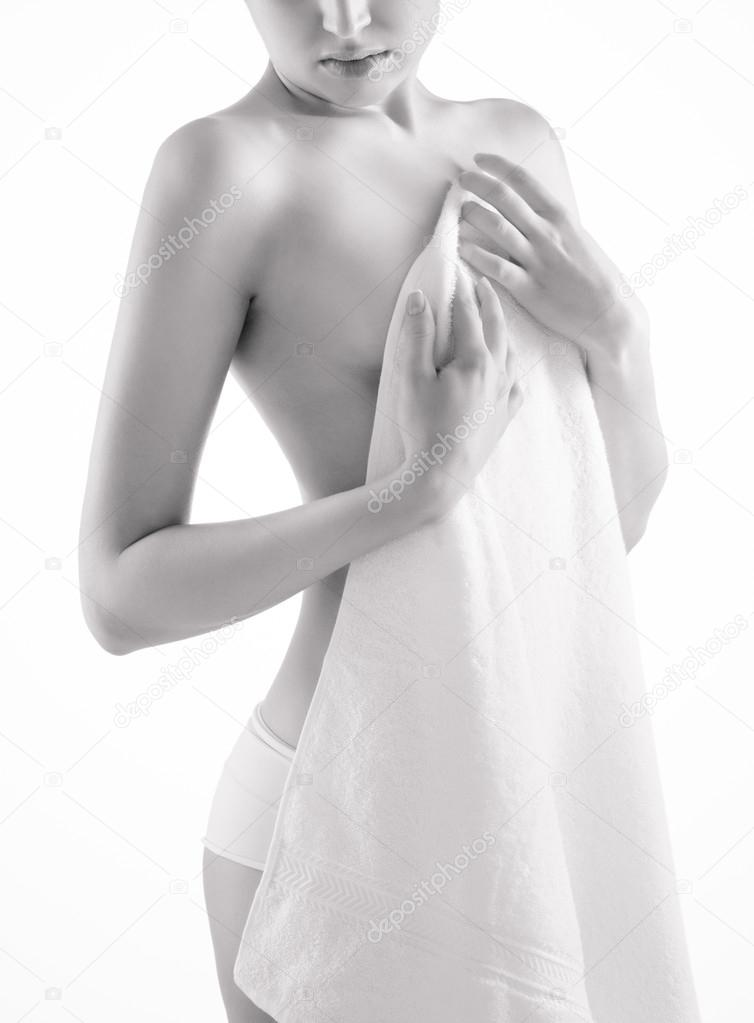 Young beautiful nude woman with towel royalty free stock