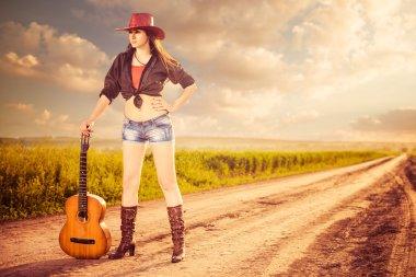 Woman in hat at rural road