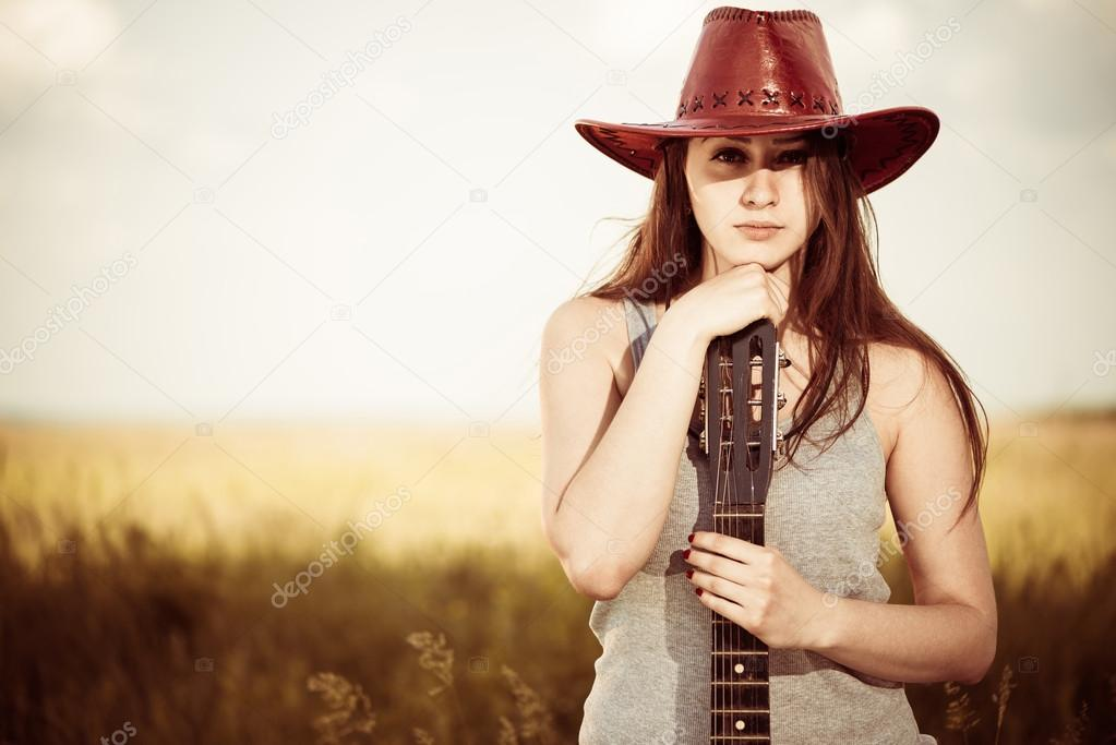 Woman with guitar outdoor portrait
