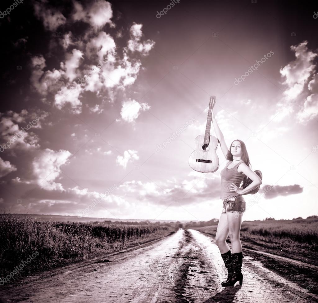 Stylish woman with guitar