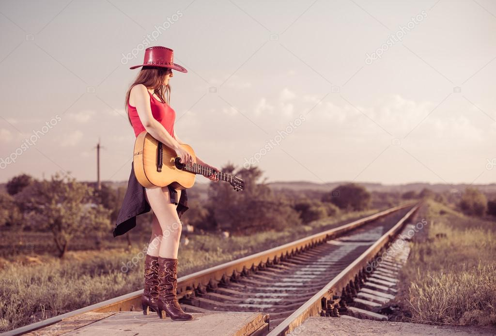Artistic woman with guitar