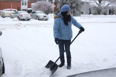 Lady Shovelling Snow
