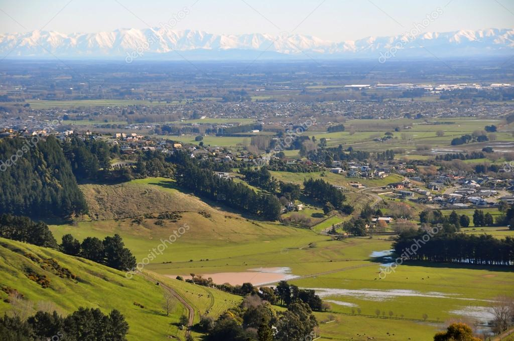 The Canterbury Plains featuring the outskirts of the city of Christchurch in the foreground and the Southern Alps in the far distance.