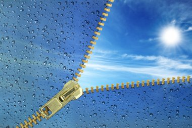 Unzipped glass with water drops revealing blue sky